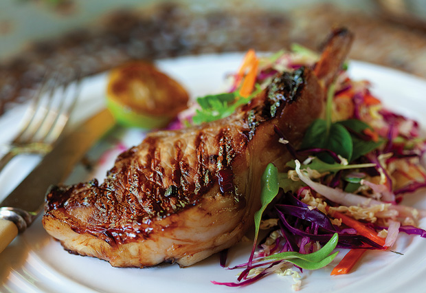 Chargrilled ginger pork cutlets with Asian salad and lemon