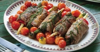 Asparagus and beef involtini with heirloom cherry tomatoes.