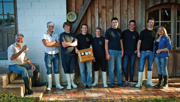 Joe (far left) and Antonia (far right) with four of their sons and three apprentices.