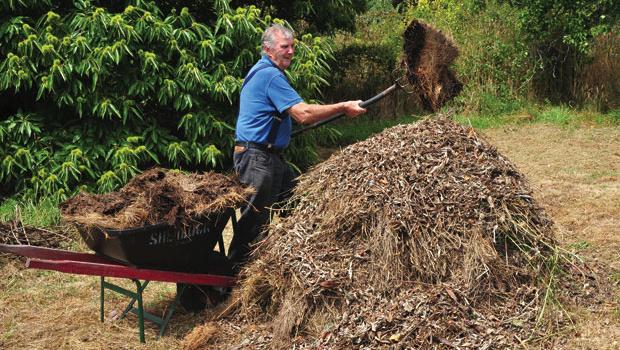 Garden expert Peter Cundall builds a leafmould mound.