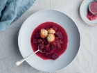 Beetroot, beef and bacon soup with cream cheese dumplings