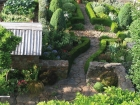 Striking stonework and hedging provides order and beauty.